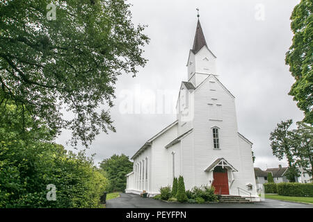 Tall white church in the town of Floro, Norway. - Stock Image