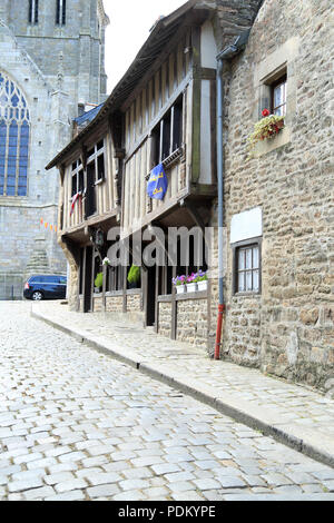 View of cobbled street and medieval buildings in Rue du Coignet, Dinan, Cotes d'Amor, Brittany, France - Stock Image