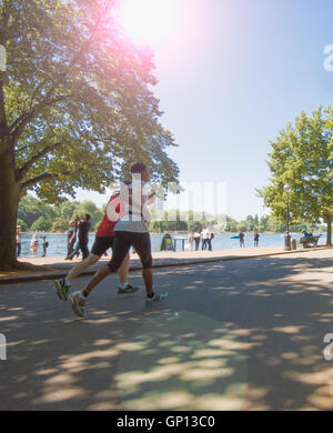 Joggers in Hyde Park, London - Stock Image