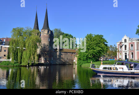 Motorboat on canal at the Eastern Gate, Delft, Holland, The Netherlands - Stock Image