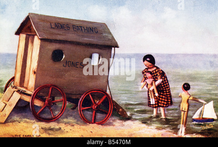 Old vintage seaside picture postcard of a  bathing machine  EDITORIAL USE ONLY - Stock Image