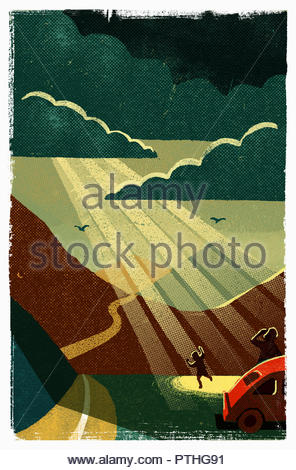 Father and son enjoying shaft of light through storm clouds on mountain road - Stock Image