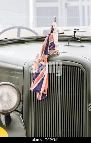 A vintage world war two jeep with a union jack flag on the front - Stock Image