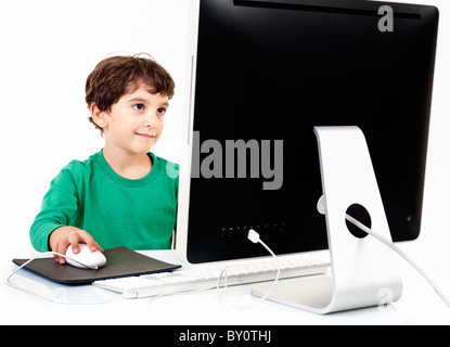 young boy with desktop computer isolated on white - Stock Image