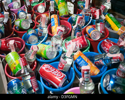 Buckets of alcoholic drinks for sale at the Full Moon Party in Haad Rin Koh Phangan Thailand - Stock Image