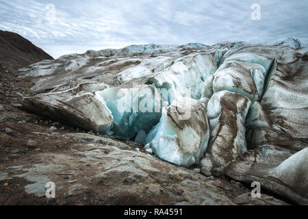 With caution, walking the glacier is faster and easier than pushing through loose moraine rocks. For me, this kind of experience was for the first tim - Stock Image