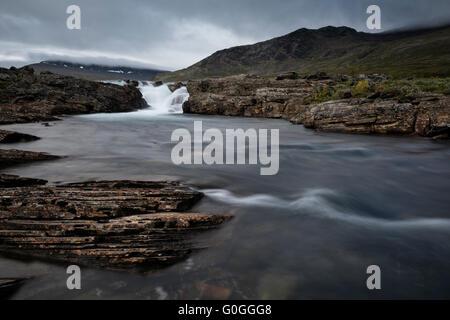 Flowing mountain river, Kungsleden Trail, Lapland, Sweden - Stock Image