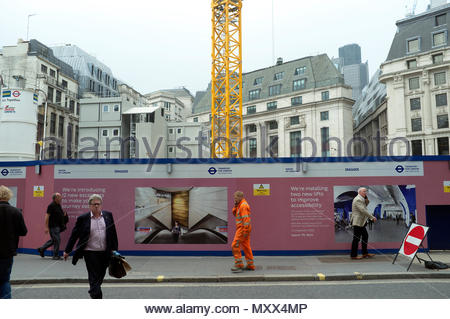Construction hoardings surround the redevelopment work of Bank underground tube station, in Cannon Street, London, UK. - Stock Image