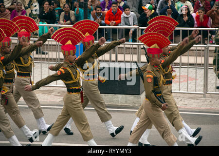 Indian Border Security Force soldiers march at the Attari-Wagah border closing ceremony the day after the Jaish-e-Mohammed terrorist attack. - Stock Image