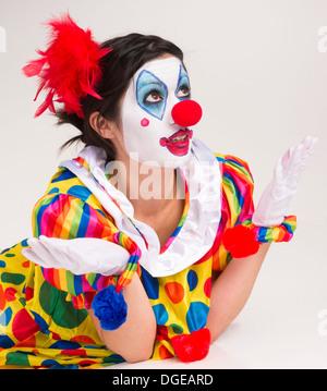 Clown; Circus; Face Paint; Female; Human Role; Behavior; Ecstatic; Cheerful; Studio Shot; Looking At Camera; Entertainment; - Stock Image