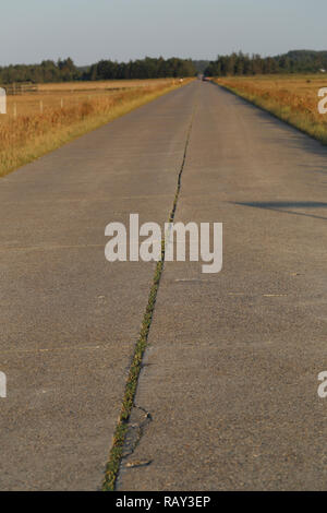 Stretch of concrete road constructed by the German occupational forces during WWII - Stock Image
