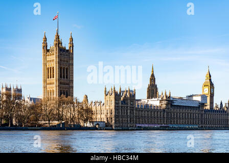 Palace of Westminster on the northern bank of the Thames - Stock Image