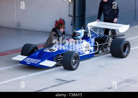 Paul Bason sitting in the cockpit of his 1971, March 712, formerly driven by James Hunt,  during the 2019 Silverstone Classic Media/Test Day - Stock Image