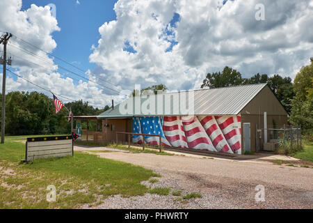 Bozeman deer and wild game processing business / building with American flag painted on the side; a feature of the American South in Alabama USA. - Stock Image