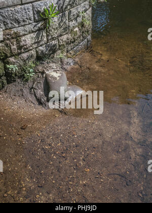 Remnants of sandbags used in flood defence. - Stock Image
