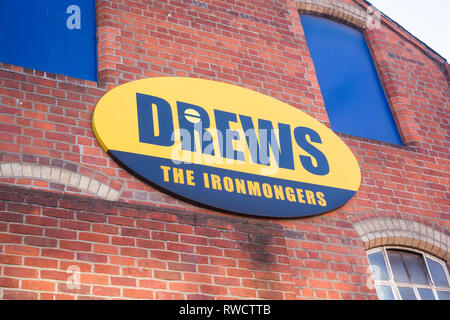 The sign on the side of 'Drews The Ironmongers' in Caversham, Reading, Berkshire which closed at the end of 2018 after 87 years in the town. - Stock Image