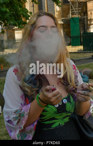 London, UK. 6th July 2018. A member of the group 'We The Undersigned Have a Legal Right to use Cannabis'  smokes a spliff for journalists at the protest in Old Palace Yard in support of Newport West Labour MP Paul Flynn's Private Member's Bill to allow the medical use of cannabis was expected to be debated this afternoon. Objections by MPs prevented the debate and it was pushed back until October. Credit: Peter Marshall/Alamy Live News - Stock Image