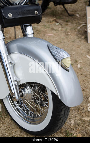 Front spoked wheel and mudguard of 2003 Indian Chief Roadmaster motorcycle. - Stock Image