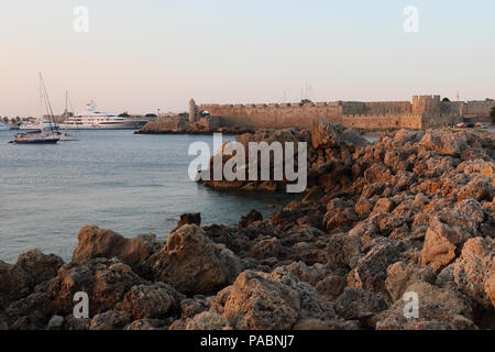 Mandraki Harbour in Rhodes, Greece at dawn. - Stock Image