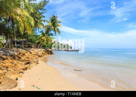 Long tail boats on the southern end of Bang Tao beach on Phuket, Thailand - Stock Image