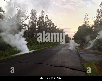 Steam vents from cracks caused by the 6.9 magnitude earthquake from the Kilauea volcanic eruption along Kaupili Street May 4, 2018 in Leilani Estates, Hawaii. The recent eruption continues destroying homes, forcing evacuations and spewing lava and poison gas on the Big Island of Hawaii. - Stock Image