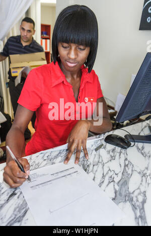 Miami Beach Florida Collins Avenue Circa 39 Hotel boutique lodging accommodation reception front desk Black woman clerk job wr - Stock Image
