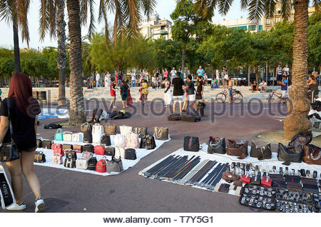 People dancing to music in the harbour amonst the street sellers on the on the  Street in the City of Barcelona in Catalunya in Spain in Europe - Stock Image