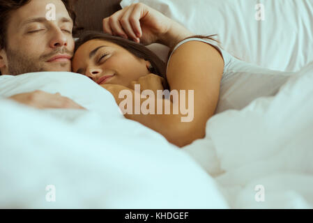 Couple sleeping in bed - Stock Image