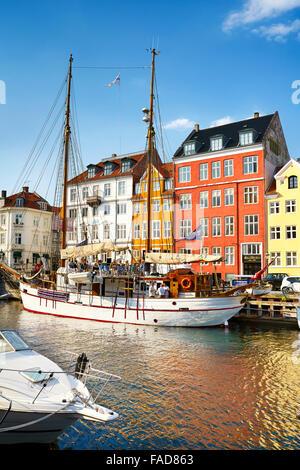 The boat in Nyhavn Canal, Copenhagen, Denmark - Stock Image