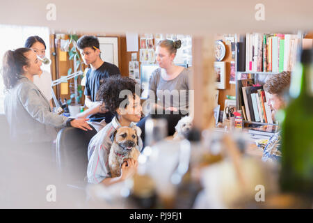 Creative designers with dogs in office - Stock Image