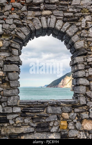 Sea view from a stone window of an old ruin castle wall in Portovenere, Liguria, Italy. - Stock Image