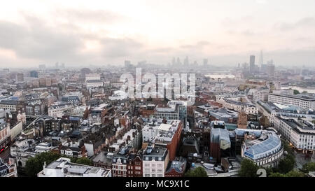 London City Central Neighborhood Aerial View Flying Over Above Leicester Square and Covent Garden Famous Landmarks Skyline in England United Kingdom - Stock Image