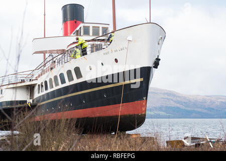Balloch, Loch Lomond, Scotland, UK. 10th Jan, 2018. The Maid of the Loch falls back into Loch Lomond leaving behind the debris of the carriage (sheared section of wood visible bottom of picture) which broke as she was being winched up the slipway. The ship fell backwards down the slipway with workers scattering out of the way just in time, with at least one worker falling into the loch Credit: Kay Roxby/Alamy Live News - Stock Image