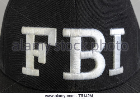 Close up of the FBI logo on a black cap. The text stands for Federal Bureau of Investigations. Frontal view. - Stock Image
