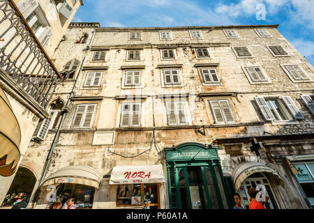 Apartments above shops and stores in Peoples Square, Diocletians Palace in old town Split Croatia on a sunny day - Stock Image