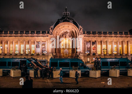 Paris, France - December 2nd, 2018: French police vans in front of Petit Palais in Paris at night following nights of protests by gilets jaunes - Stock Image