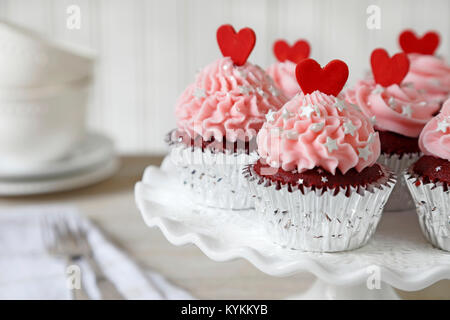 Cupcakes. Red velvet cupcakes decorated with red hearts - Stock Image