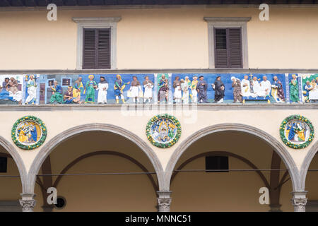 Ceramic frieze showing the seven works of mercy outside the medieval hospital or Ospedale del Ceppo, Pistoia, Tuscany, Italy, Europe - Stock Image