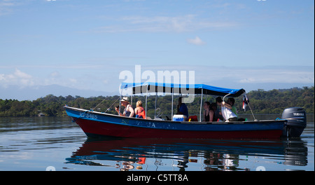 Tourists on Boat Tour in the Bocas del Toro Archipelago with view of Mangrove forest . - Stock Image
