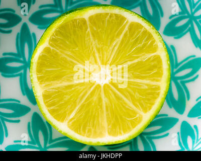 Half a Lime in fruit bowl - Stock Image