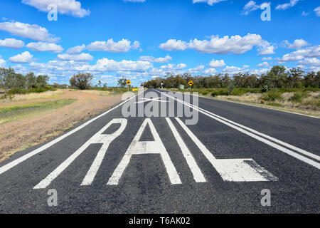 Railway line road markings on the Carnarvon Highway in Queensland interior, QLD, Australia - Stock Image