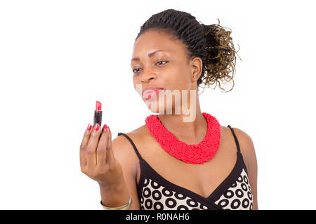 Portrait of a young woman holding lipstick and looking at him with joy. - Stock Image