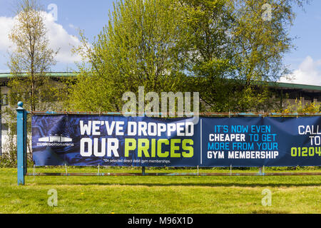Gym membership advertising banner outside Bolton Arena indoor sports arena at Middlebrook Retail and Leisure Park, Horwich. - Stock Image