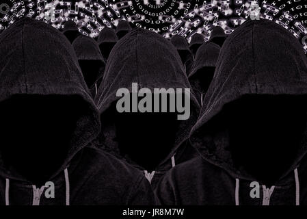 Multitude of hooded unknown mysterious computer criminals with binary code background - Stock Image