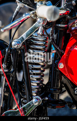 Big spring of shock absorber of a red, historic, italian motorcycle Gilera 250 Nettuno from 1949 year. - Stock Image