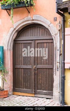 Old door in Riquewih, Haut-Rhin, Alsace, France - Stock Image