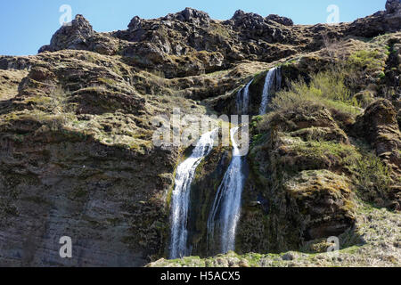 Two waterfalls flowing down on rock - Stock Image