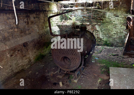 Old boilerhouse in a derelict mill, Linthwaite, West Yorkshire - Stock Image