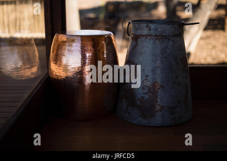 Wooden and ceramic pitcher - Stock Image
