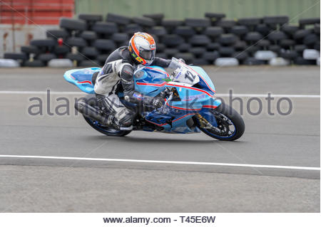 East Fortune, UK. 14 April, 2019. 12 William Monie riding a BMW S1000RR in a Scottish Superbikes and Formula Melville Championship race at East Fortune Raceway, during the opening rounds of the 2019 Scottish Championships, Melville Open and Club Championships. Credit: Roger Gaisford/Alamy Live News - Stock Image